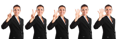 One to five. Businesswoman counting from one to five Royalty Free Stock Photography