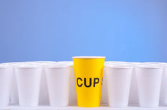 One to rule them all. One yellow cup, which leads all Royalty Free Stock Photography