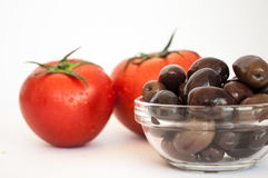 One tomato isolated in white and olives Stock Photography