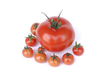 One tomato with small tomatoes isolated on white Royalty Free Stock Images