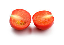 One tomato split in half isolated on white background Royalty Free Stock Photos