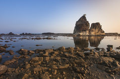 Sawarna Beach in the morning. One of the top destination located on Banten, Indonesia. This photograph is about iconic big stone called Tanjung Layar (sail) Royalty Free Stock Photo