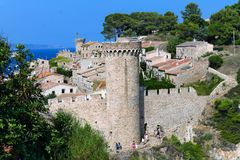 One of the towers of the historic fortress in Tossa de Mar, Catalonia. stock images