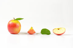 One and two quarters apples Royalty Free Stock Photos