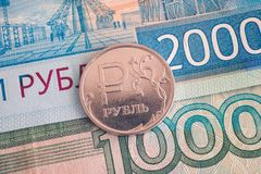 One and Two thousand ruble banknotes and one-ruble coin on it Stock Image