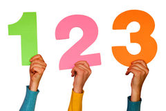 One,two and three. Colorful numbers at hands Stock Image