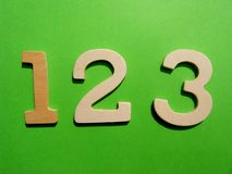 One two three. Numbers one two and three on green background stock photo