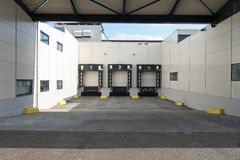 One Two Three. Loading docks for trucks, numbered one, two and three royalty free stock image