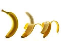 One two three bananas. Three bananas some peeled on white background stock photos