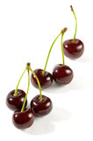 One Two and Three Cherries. Close-up Isolated over white background royalty free stock photos