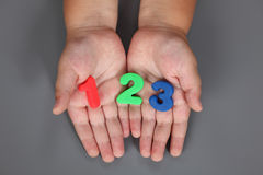 One, two, three in child hands Stock Image