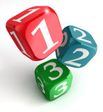 One two three numbers on dice box. One two three numbers on red blue green box on white background Stock Photos
