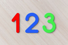 One, two and three on a wooden table horizontally. Multi-colored number one, two and three on a wooden table horizontally Stock Images