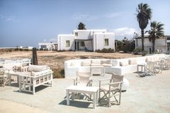 Typical guesthouse on Antiparos, Greece. One of the typical guesthouses with bar and restaurant in Antiparos, one of the Cyclade islands in Greece stock image
