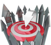 One Unique Arrow Better Than Rest Find Target. One unique arrow does a better job than its competition - other arrows - at locating and hitting a bulls-eye Stock Photo