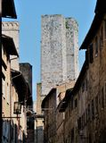 One of unique medieval stone towers in San Gimignano, Tuscany, Italy stock photography