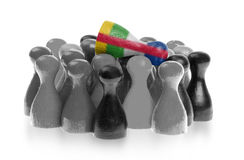 One unique pawn on top of common pawns Royalty Free Stock Photos
