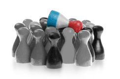 One unique pawn on top of common pawns Stock Photography