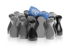 One unique pawn on top of common pawns Stock Images
