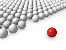One unique red ball among other white Royalty Free Stock Images
