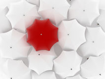 One unique red umbrella, among other white. Many white umbrellas. One red unique umbrella Stock Images