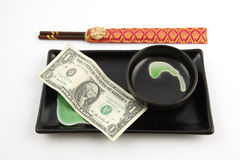 One United States dollar bill on a sushi plate Royalty Free Stock Photography