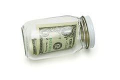 One US dollar in glass jar Royalty Free Stock Photo