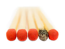 One used match. One match out of five is used Royalty Free Stock Photo