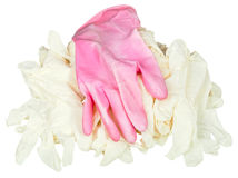 One used pink glove on pile of new medical gloves Stock Photo