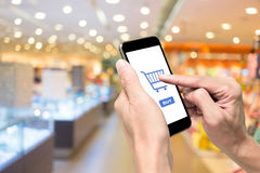 One using smartphone for e-commerse stock images