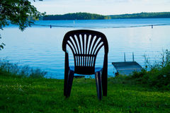 One vacant place. Available, empty chair by a lake Stock Images