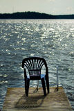 One vacant place. Available, empty chair by a lake Stock Photos