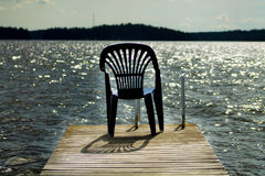 One vacant place. Available, empty chair by a lake Royalty Free Stock Photography