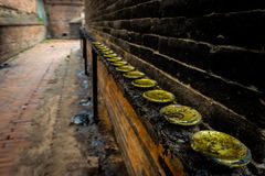 One vanishing point and dirty nepalese butter candles holders royalty free stock photos