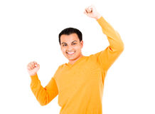 One very happy, energetic, and handsome male with his arms raised Stock Image