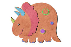 One vibrant colors dinosaur recycled paper craft stick on paper Stock Images