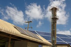One village is equipped with solar panels to provide electricity to the utilities system.  Stock Photography