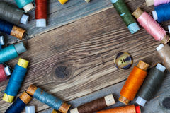 One vintage button and coils of different threads Stock Photography