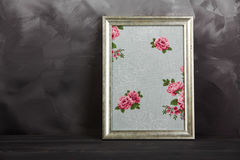 One vintage photo frames with texture roses on shabby gray background. Royalty Free Stock Photo