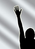 One voice vote hand. Black silhouette of a person with hand raised on a gray background-use conceptually for votes, voting, human rights, choice, volunteers Stock Images