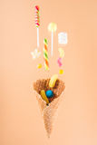 One waffle cone with different delicious jelly candies and lollipops Stock Photography