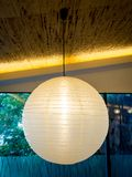 One Warmly colored balloon white paper lanterns hanging from th stock photos