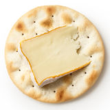 One water biscuit with cheese, isolated from above. Stock Image
