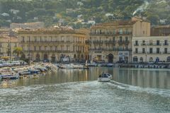 One of the waterways in downtown Sete France as a boat cruises slowly towards a pier Stock Photo