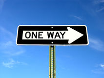One Way. A one way sign isolated agaist the sky Royalty Free Stock Images