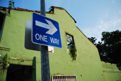 One Way. Picture of sign showing there's only one way. Against the background of the old building, the picture suggests that the only way is to improve and not Stock Photography