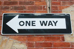 One Way. A one way sign on a brick wall Royalty Free Stock Photography