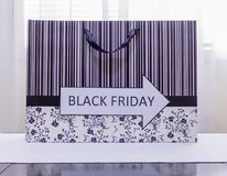 One way Black Friday sale on shooping bag. One way Black Friday sale on shopping bag with bar code Royalty Free Stock Image