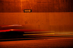 One Way Blur. The blurred lights and form of a car on a one way urban street with arrow sign stock image