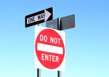 One Way - Do Not Enter Sign. Image of one way do not enter sign against clear blue sky Royalty Free Stock Photo